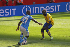 Armero in Arsenal-Napoli. Image of Pablo Armero, winger from Colombia playing for Napoli, against Sagna (from Arsenal) during the match Arsenal-Napoli for the royalty free stock photos