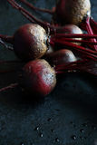 Armful of beets on a baking sheet Stock Image