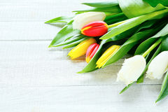 Armful of flowers on a wooden background Royalty Free Stock Photo