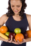 Armful of fruit looking down Stock Images