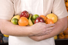 Armful of fruit man Royalty Free Stock Images