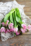 Armful of pink tulips on the boards Royalty Free Stock Photography
