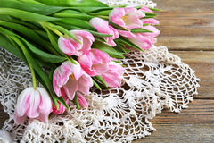 Armful of tulips on the boards Stock Image