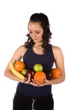 Armfull of fruit looking at it Stock Image