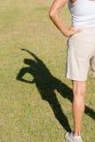Armi della siluetta dell'ombra sulla donna Fotografia Stock