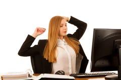 Armi dello stretche della donna di affari durante il lavoro in ufficio Immagine Stock Libera da Diritti
