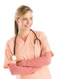 Armi di With Stethoscope Standing dell'infermiere attraversate Fotografia Stock