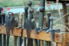 Armi medievali su una pila di legno Immagine Stock Libera da Diritti
