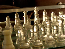 Armies. The chessboard with transparent players Royalty Free Stock Photos