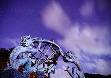 Armillary sphere with galaxy sky Royalty Free Stock Images
