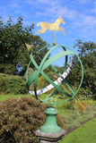 Armillary sundial, kitchen garden at Kellie Castle. View of the top part of the Armillary sundial in the kitchen garden at Kellie Castle in Fife, Scotland Royalty Free Stock Images