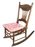 Armless Rocking Chair. Antique armless rocking chair with pillow seat cushion Royalty Free Stock Photos