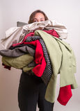 Armload of clothes Stock Image