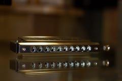 Armonica cromatica su una tavola di vetro Fotografie Stock Libere da Diritti