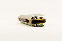 Armonica diatonica isolata su fondo bianco Fotografia Stock