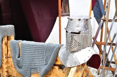 Armor and helmet. Medieval armor helmet and swords Royalty Free Stock Images