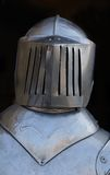 Armor Helmet. This is a closeup shot of the helmet from a suit of armor.  It was in a shop in the medieval city Monteriggioni, Italy Royalty Free Stock Photos