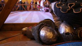 Armor and helmet at Fighting of knights - iron chain armour near arena stock video footage