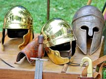 Armor and helmets of ancient Roman origin and medieval helmets o Royalty Free Stock Photo