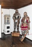 Armor of knights are in the armory room in the Bran Castle. BranArmor of knights are in the armory room in the Bran Castle. Bran c Royalty Free Stock Images