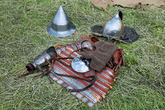 Armor. Medieval military armor lying on the grass Stock Photo