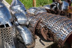 Armor of participants in the competition for the Medieval Battle. Тhеrе are a helmet, plate armor, bracers  and metal mittens. Armor of participants in royalty free stock photo