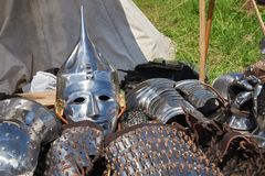 Armor of participants in the competition for the Medieval Battle. Тhеrе are a helmet, plate armor, bracers  and metal mittens. Armor of participants in stock photography