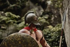 Gladiator in helmet posing with arms Stock Images