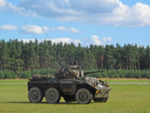 Armored car M8 Greyhound. PILSEN, CZECH REPUBLIC - AUGUST 28: US Army attacking with armored car M8 Greyhound during a demonstration at the Pilsen airshow on Stock Image