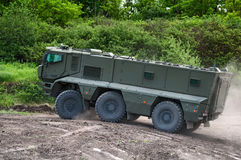 The armored car of `Typhoon-K`. Demonstration of the capabilities of the new armored personnel carrier during breaks in the competitions of survival races. The Royalty Free Stock Photo