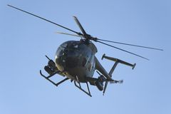 Armored Combat Helicopter. An Armored Combat Helicopter in Flight royalty free stock photo