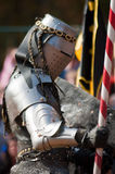 Armored joust knight. Armored rider with lance on horse royalty free stock images