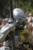 Armored knight. Getting ready for battle. Renaissance festival. USA Stock Photography