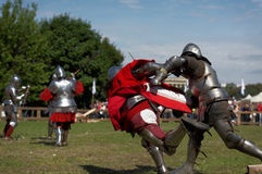 Armored knight during the battle. St. Petersburg, Russia - July 9, 2017: Armored knight fighting in the tournament during the military history project Battle On Royalty Free Stock Photo