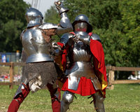 Armored knight during the battle. St. Petersburg, Russia - July 9, 2017: Armored knight fighting in the tournament during the military history project Battle On Stock Photography
