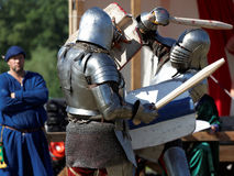 Armored knight during the battle. St. Petersburg, Russia - July 9, 2017: Armored knight fighting in the tournament during the military history project Battle On Royalty Free Stock Image
