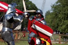 Armored knight during the battle. St. Petersburg, Russia - July 9, 2017: Armored knight fighting in the tournament during the military history project Battle On Royalty Free Stock Images