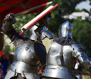 Armored knight during the battle. St. Petersburg, Russia - July 9, 2017: Armored knight fighting in the tournament during the military history project Battle On Royalty Free Stock Photography
