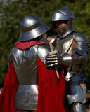 Armored knight during the battle. St. Petersburg, Russia - July 9, 2017: Armored knight fighting in the tournament during the military history project Battle On Royalty Free Stock Photos