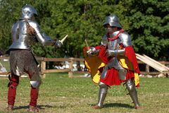 Armored knight during the battle. St. Petersburg, Russia - July 9, 2017: Armored knight fighting in the tournament during the military history project Battle On Stock Photo