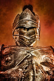 Armored Knight Looking Down Red Orange Sky Stock Photos