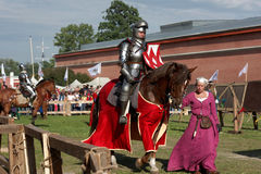 Armored knight participating in jousting. St. Petersburg, Russia - July 9, 2017: Armored knight on a horse participating in the jousting tournament during the Royalty Free Stock Photos