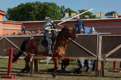 Armored knight participating in jousting. St. Petersburg, Russia - July 9, 2017: Armored knight on a horse participating in the jousting tournament during the Stock Photo