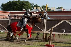 Armored knight participating in jousting stock images