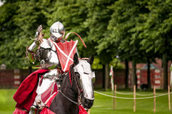 Armored knight suited for battle on horseback Royalty Free Stock Photos