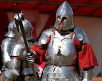 Armored knights preparing to the battle. St. Petersburg, Russia - July 9, 2017: Armored knights preparing to the tournament during the military history project Royalty Free Stock Photos
