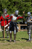 Armored knights preparing to the battle. St. Petersburg, Russia - July 9, 2017: Armored knights preparing to the tournament during the military history project Royalty Free Stock Image