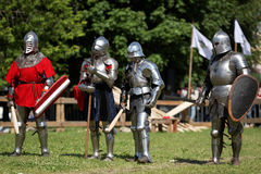Armored knights preparing to the battle Stock Images