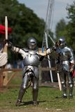 Armored knights preparing to the battle. St. Petersburg, Russia - July 9, 2017: Armored knights preparing to the tournament during the military history project Stock Photos