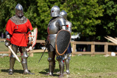 Armored knights preparing to the battle. St. Petersburg, Russia - July 9, 2017: Armored knights preparing to the tournament during the military history project Royalty Free Stock Photo